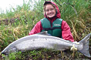 Happy angler after a sucessful fishing trip in Anchorage AK.